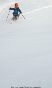 An image of Dylan Telemark skiing in powder on the Showtime trail at Bolton Valley Ski Resort in Vermont