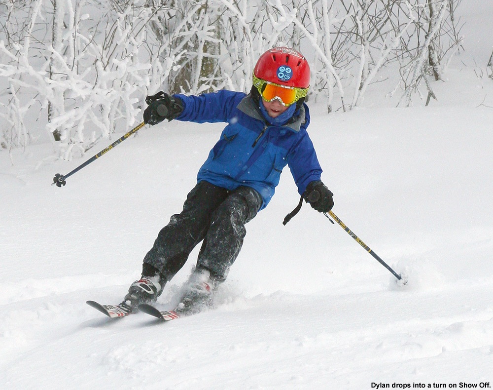 An image of Dylan leaning into a turn in soft snow on the Show Off trail at Bolton Valley Ski Resort in Vermont
