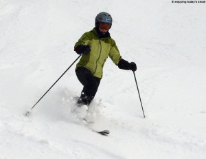 An image of Erica skiing in some powder on the Show Off trail at Bolton Valley Ski Resort in Vermont