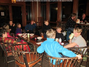 An image of children and adults enjoying some apres ski time at the Spruce Camp Bar at Stowe Mountain Resort in Vermont