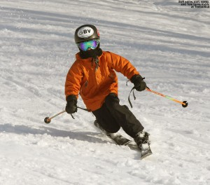 An image of Ty Telemark skiing on a warm January day in soft snow at Bolton Valley Resort in Vermont