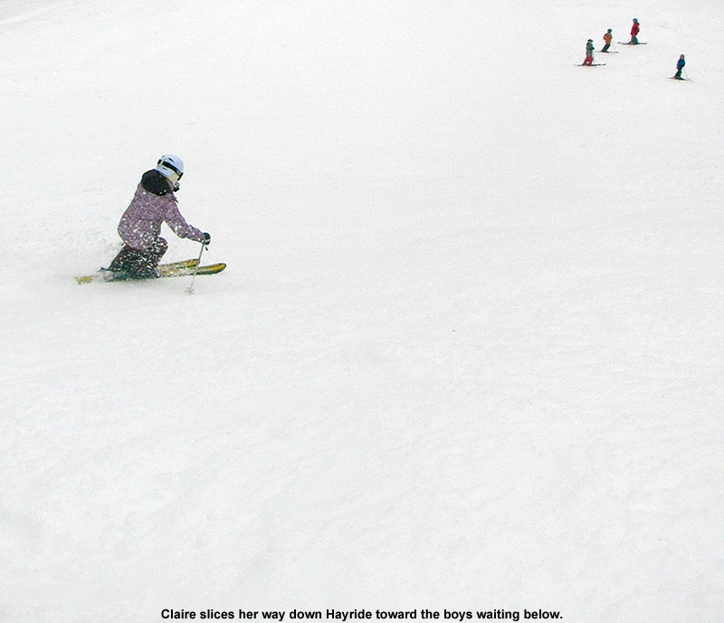 An image of Claire skiing the Hayride trial at Stowe Mountain Resort in Vermont