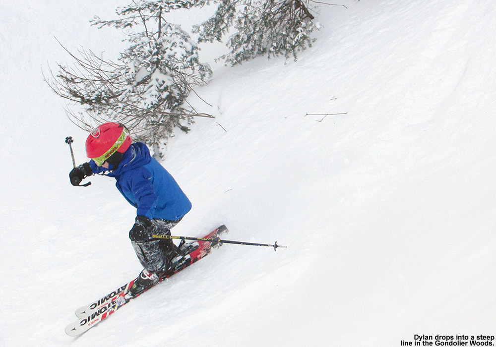 An image of Dylan skiing a steep line in the Gondolier Woods at Stowe Mountain Resort in Vermont