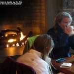 An image of Apres Ski time in front of the fire at the Spruce Camp Bar at Stowe Mountain Resort in Vermont