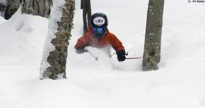 An image of Ty skiing waist deeppowder in the KP Glades at Bolton Valley Resort in Vermont thanks to winter storm Nemo