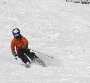 An image of Ty skiing in soft snow in the Meadows area at Stowe Mountain Resort in vermont
