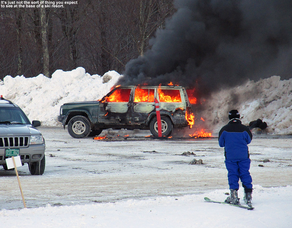 An image of a burning SUV in the Midway parking lot at Stowe Mountain Resort in Vermont