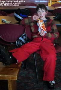 An image of Luke having a snack in the Midway Lodge at Stowe Mountain Ski Resort in Vermont