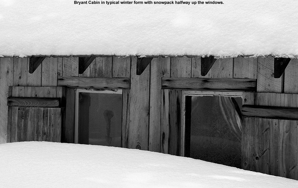 An image of Bryant Cabin in the Bolton Valley backcountry showing the snow depth outside reaching halfway up the windows