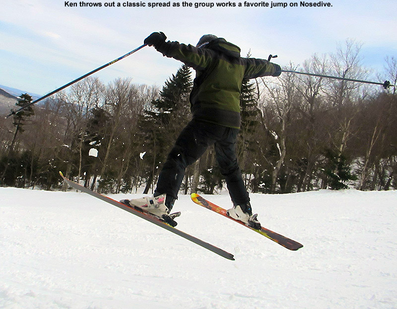 An image of Ken in a spread eagle jump on the Nosedive trail at Stowe Mountain Ski Resort in Vermont