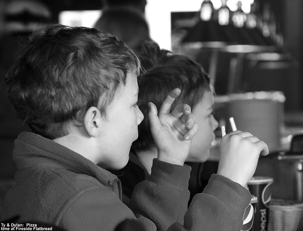 A black and white image of Ty and Dylan at the Fireside Flatbread restaurant at Bolton Valley Ski Resort in Vermont