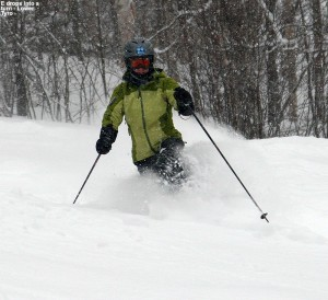 An image of Erica Telemark skiing in powder on the Lower Tyro trail at Stowe Mountain Resort in Vermont during a nor'easter