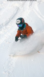 An image of Ty skiing in powder down the Intro headwall area at Bolton Valley resort in Vermont