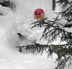 An image of Dylan skiing deep powder in the KP Glades area at Bolton Valley Ski Resort in Vermont
