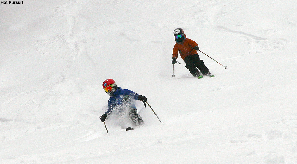 An image of Dylan and Ty skiing powder on the Spell Binder trail at Bolton Valley Resort in Vermont