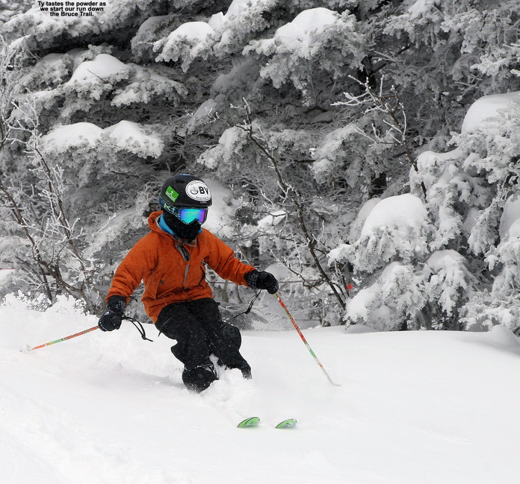 An image of Ty skiing powder at the top of the Bruce Trail at Stowe Mountain Resort in Vermont