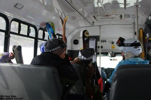 An image of skiers riding the Mountain Road Shuttle Bus in Stowe