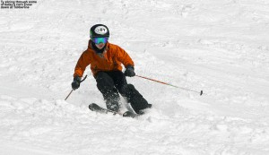 An image of Ty skiing in spring corn snow on the Spell Binder trail in the Timberline area at Bolton Valley Resort in Vermont