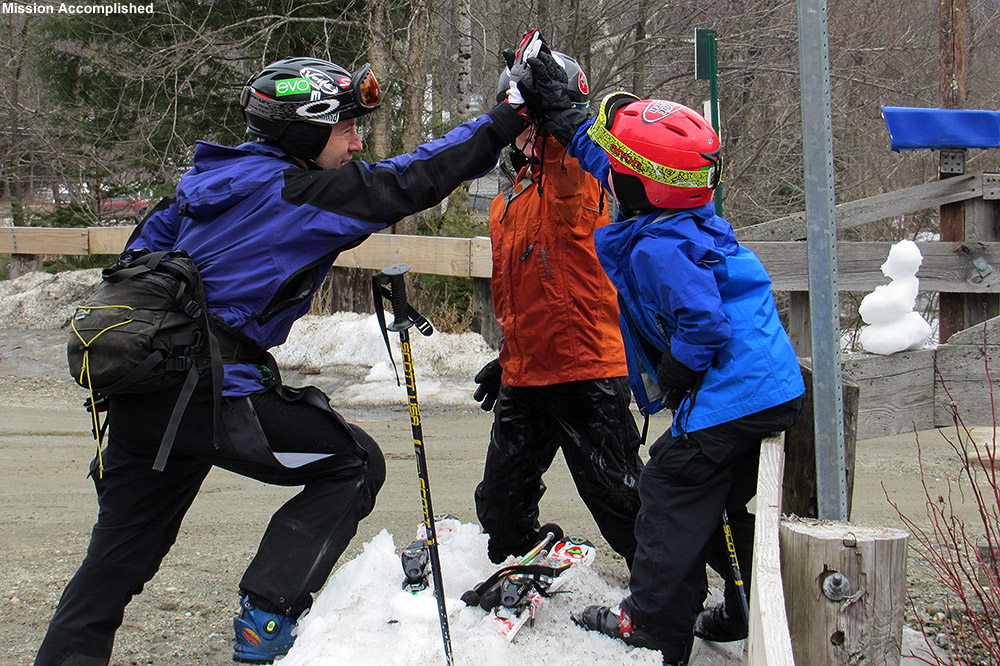 "An image of Jay, Ty, and Dylan giving each other a ""high five"" near the Matterhorn in Stowe, Vermont after finishing off a run of the Bruce backcountry ski trail"