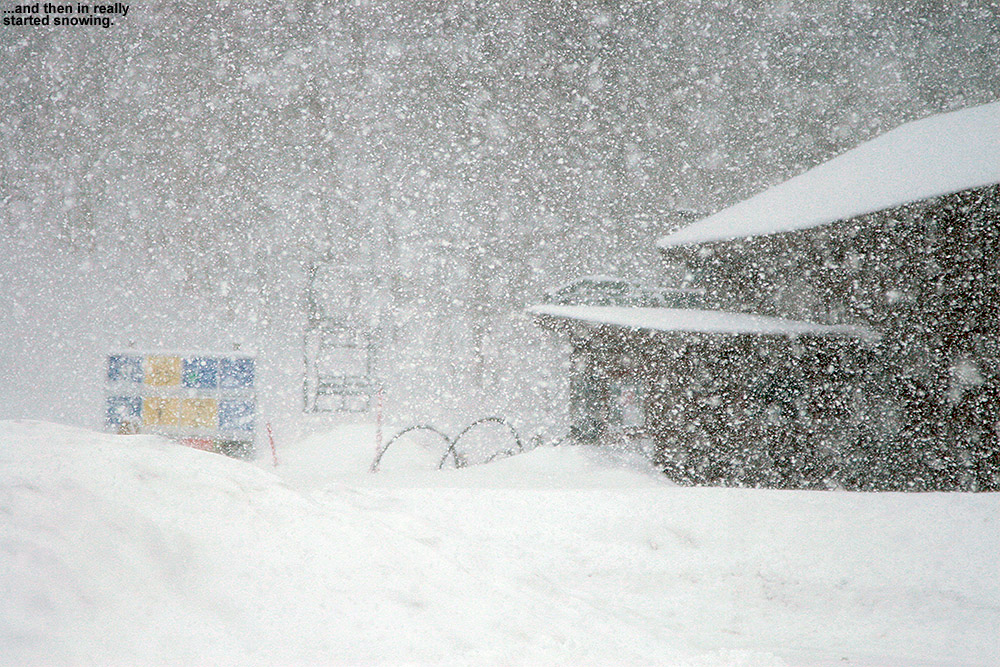 An image of heavy snowfall at the base of Bolton Valley Ski Resort in Vermont during an early April snowstorm