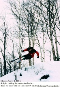 An image of Jay jumping off the side of the trail on skis at Stowe Mountain Ski Resort in Vermont