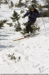 An iamge of Jay skiing in one of the alpine gullys up above Stowe Mountain Ski Resort in Vermont