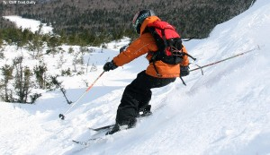 An image of Ty skiing in the Cliff Trail Gully in the alpine terrain above Stowe Mountain Resort in Vermont