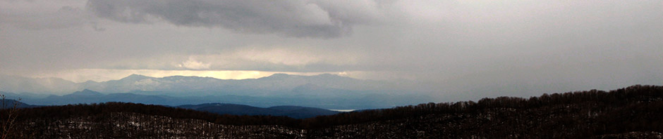 An image of the Adirondacks with snow squalls approaching taken from the Timberline area of Bolton Valley Ski Resort in Vermont