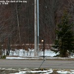 An image of the entrance to the Ponds event area at Bolton Valley Ski Resort in Vermont showing a lit street lamp in the afternoon in April due to cloudiness and snowfall