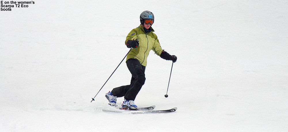 An image of Erica skiing in spring snow at Stowe Mountain Resort in Vermont as she tries out the Scarpa Women's T2 Eco Telemark ski boots