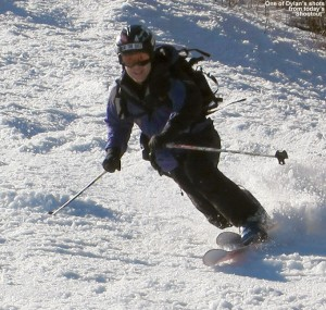 An image of Jay in a Telemark turn in spring snow on the Gondolier trail at Stowe Mountain Ski Resort in Vermont