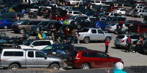 An image of skiers tailgating in a packed Mansfield parking lot at Stowe Mountain Ski Resort in Vermont