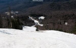 An image looking down the Spillway trail at Bolton Valley Ski Resort in Vermont on a sunny spring afternoon