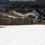 an image looking down toward the steep pitch of the West Slope trail at Stowe Mountain Ski Resort in Vermont  on a day of spring skiing in May