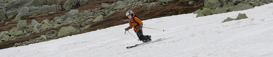 An image of Ty Telemark skiing on one of the Mt. Washington snowfields in New Hampshire