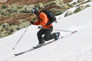 An image of Jay Telemark skiing on the East Snowfields of Mt. Washington in New Hampshire in May