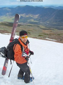 An image of Jay carrying his skis on his pack on one of the snowfields on the east side of Mt. Washington in New Hampshire
