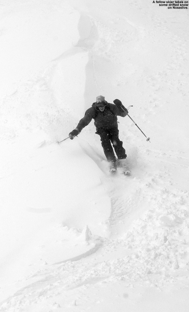 An image of a skier  on the Nosedive trial at Stowe Mountain Resort in Vermont during a Memorial Day Weekend snowstorm