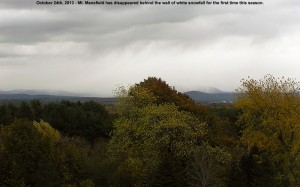 An image of Mt. Mansfield in Vermont hidden behind the first snowfall of the season in October