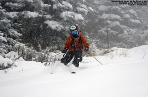 An image of Ty skiing early October powder on the Perry Merrill trail at Stowe Mountain Resort in Vermont