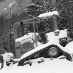 An image of snow-covered bulldozer between the Perry Merrill and Gondolier Ski Trails at Stowe Mountain Resort in Vermont during an October storm