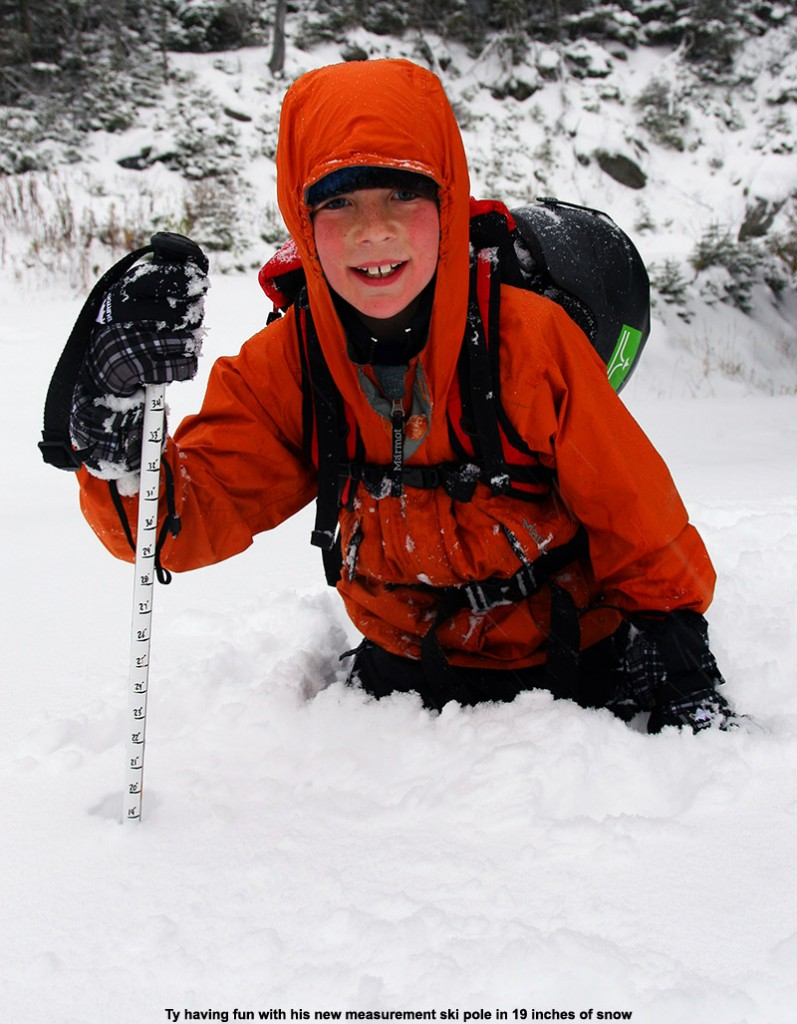 An image of Ty in 19 inches of October snow up near the Cliff House at Stowe Mountain Resort in Vermont