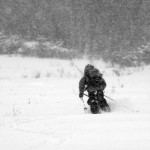 An image of Ty skiing away in an October snowstorm at Stowe Mountain Resort in Vermont