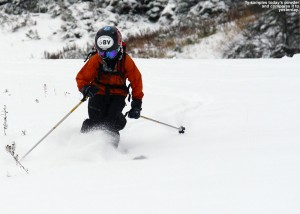 An image of Ty skiing powder on the Perry Merrill trail at Stowe in October