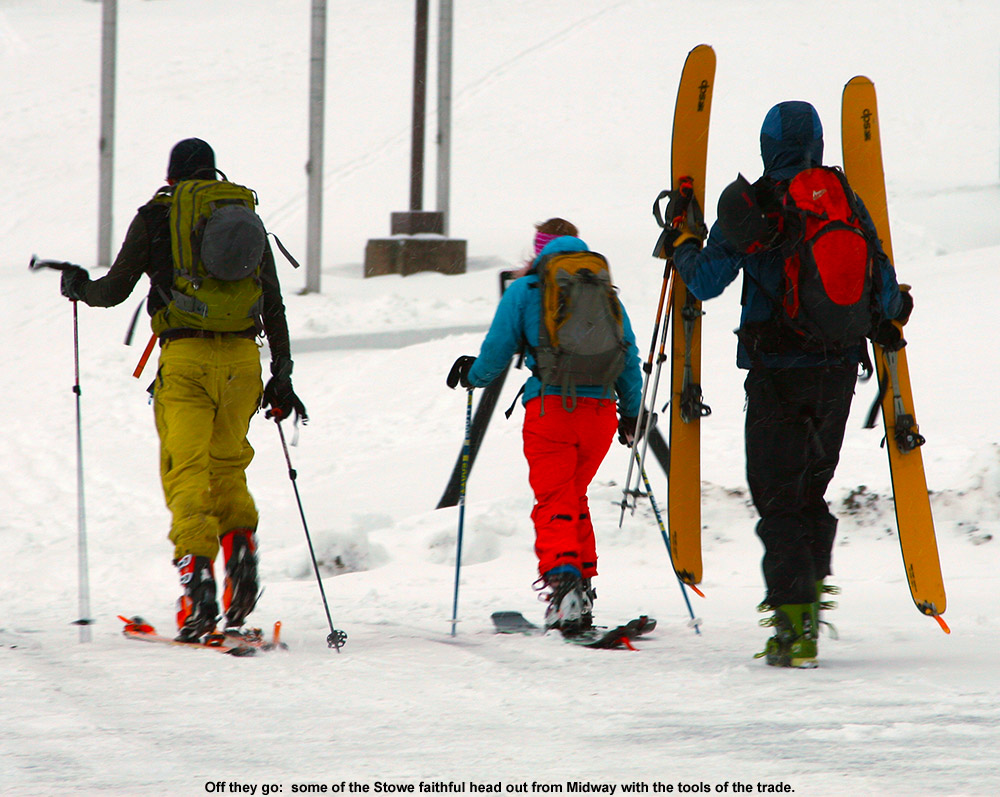 An image of skiers heading out from the Midway parking lot  at Stowe for a November ski tour