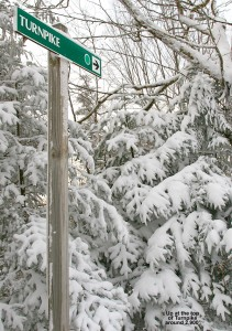 An image of the Turnpike ski trail sign with snowy trees at the Bolton Valley Ski Resort in Vermont
