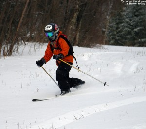 An image of Ty skiing in powder on the Turnpike trail at Bolton Valley Ski Resort in Vermont