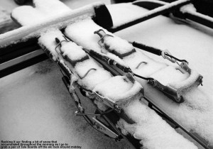 An image of Telemark skis with snow on them on a car ski rack at Stowe Mountain Ski Resort in Vermont