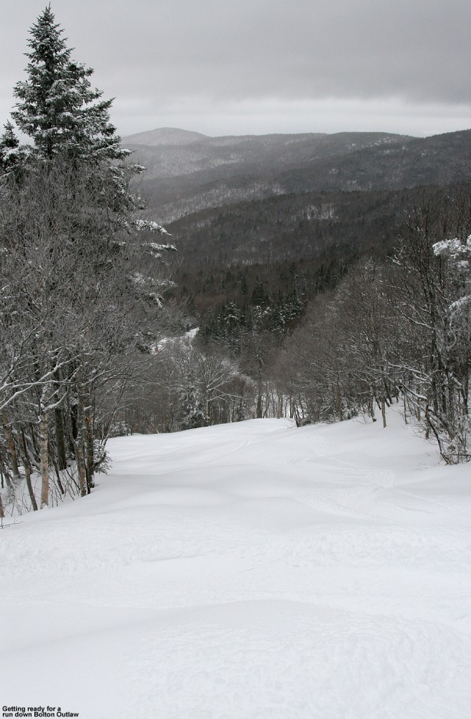 An image looking down the Bolton Outlaw trail with fresh snow at Bolton Valley Ski Resort in Vermont