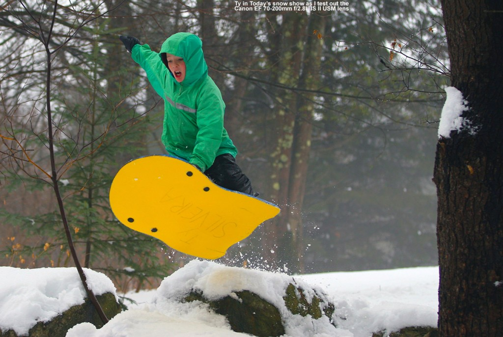 An image of Ty jumping on his sled